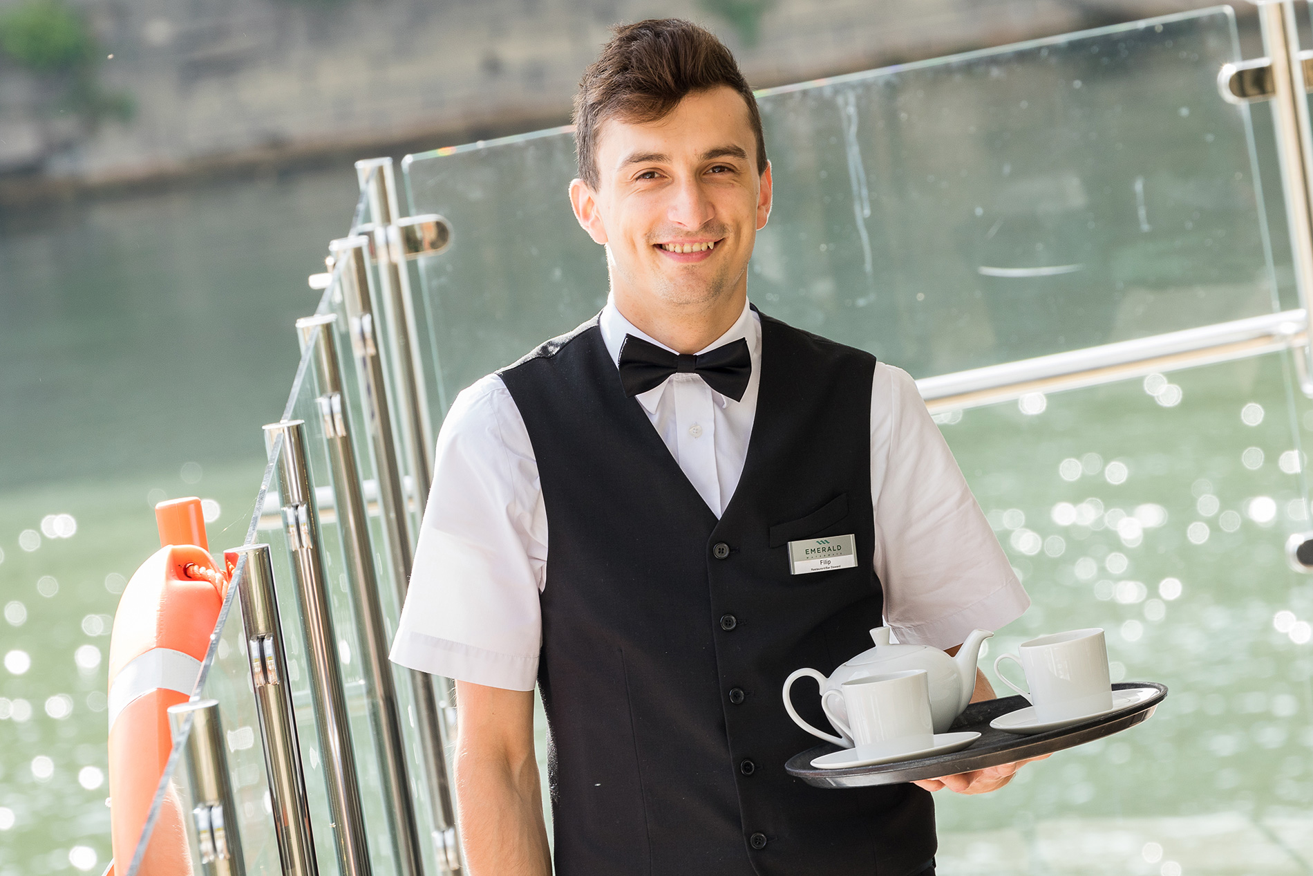 Emerald Waterways on board staff serving drinks