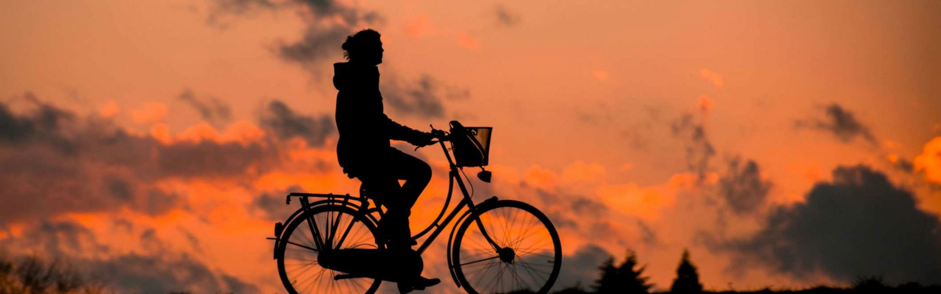 a bicycle with a sunset in the background
